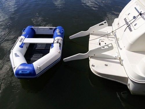 Tilting pull-on davit system for soft bottom inflatable boats