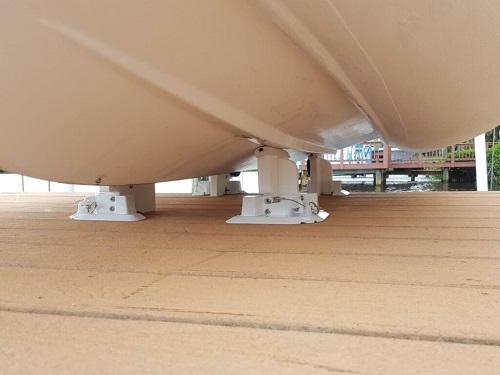 Dinghy tender chock wheeled system for docks